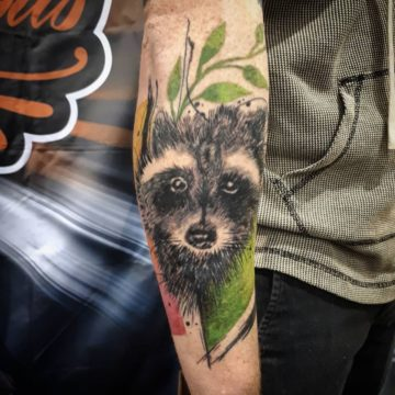 avant garde raccoon tattoo