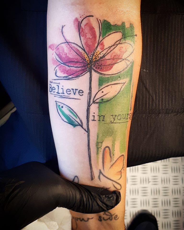 avant-garde flower sketch tattoo